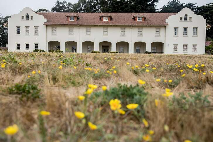 A large field sits between original barracks buildings at Fort Scott in the Presidio of San Francisco, Calif. Tuesday, July 17, 2018.