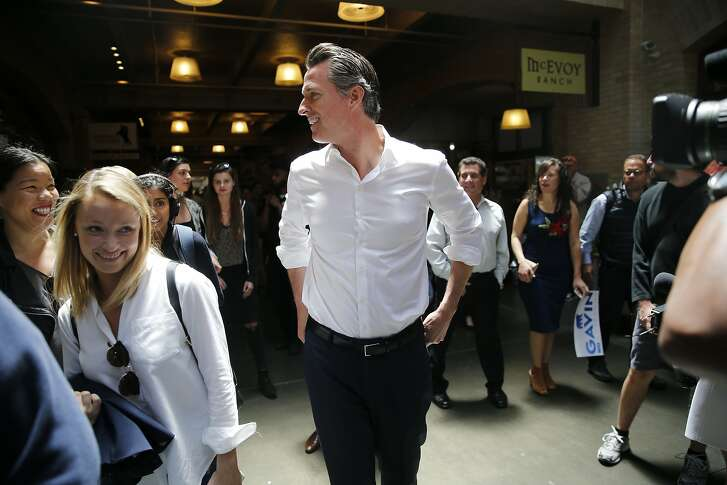 Gavin Newsom greets supporters inside the Ferry Building, Wednesday, June 6, 2018, in San Francisco, Calif. Lt. Gov. Newsom (D) will face Republican businessman John Cox in the race to be the next Governor of California.
