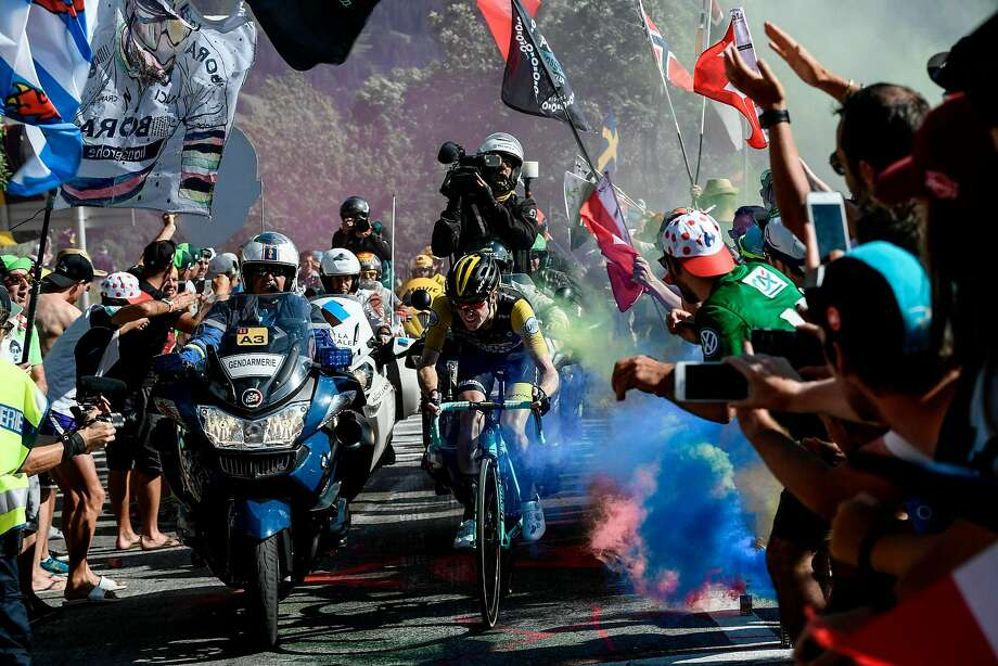 In a chaotic Stage 12 on Thursday, the Netherlands' Steven Kruijswijk rides through flare bomb smoke furing the ascent to l'Alpe d'Huez. Photo: Philippe Lopez / AFP / Getty Images