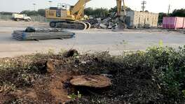 "Only a stump remains where the ""Hero Tree,"" which was dedicated to honor Capt. Gary Herod in 1961, was cut down in Meyerland Plaza on Tuesday, July 17, 2018."