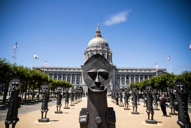 The Invisible Man and the Masque of Blackness sculpture installation by Zak Ov� is seen at Civic Center Plaza in San Francisco, Calif. on Thursday, July 19, 2018.