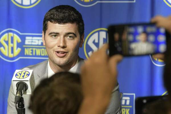 NCAA college football quarterback Jarrett Stidham of Auburn is interviewed during the Southeastern Conference Media Days at the College Football Hall of Fame in Atlanta, Thursday, July 19, 2018. (AP Photo/John Amis)