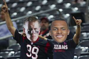 Houston Texans fans dress up as Houston Texans defensive end J.J. Watt (99) and quarterback Deshaun Watson (4) before the Houston Texans take on the Kansas City Chiefs at NRG Stadium Sunday, Oct. 8, 2017 in Houston. ( Michael Ciaglo / Houston Chronicle)