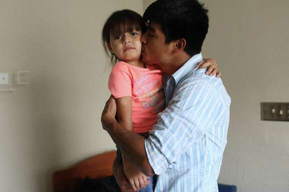 EL PASO, TX - JULY 19: A man, identified only as Wilson  hugs his daughter, Sandra, 5, at an Annunciation House facility after they were reunited earlier today on July 19, 2018 in El Paso, Texas.  The two, orginally from Honduras,  were reunited in an I.C.E processing center after being separated for two months when they tried to cross into the United States. A court-ordered July 26th deadline is approaching for the U.S. government to reunite as many as 2,551 migrant children ages 5 to 17 that had been separated from their families.  (Photo by Joe Raedle/Getty Images)