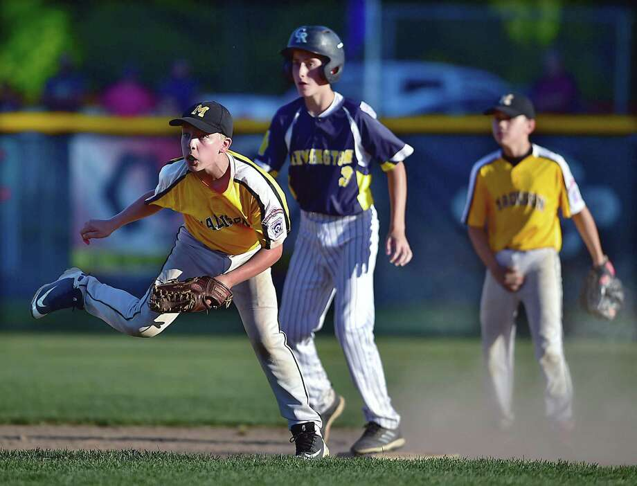 Madison shortstop Ben Kuja throws to first in an attempt at a double play against Newington on Thursday in Rocky Hill. Photo: Catherine Avalone / Hearst Connecticut Media / New Haven Register