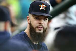 Houston Astros starting pitcher Dallas Keuchel (60) talks with his teammates in the dugout while the Houston Astros host the Detroit Tigers at Minute Maid Park on Saturday, July 14, 2018. Astros won the game 9-1 and lead the Tigers 2-0 in the series.( Elizabeth Conley / Houston Chronicle )