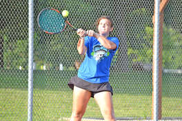 Mady Schreiber, a 2018 Edwardsville graduate, returns a shot during Thursday's inaugural High School Tennis All-Star Game at the EHS Tennis Center. The event featured a Madison County vs. St. Clair County format.