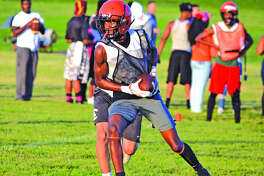 Edwardsville wide receiver Lavontas Hairston catches a pass during a 7-on-7 scrimmage Monday.