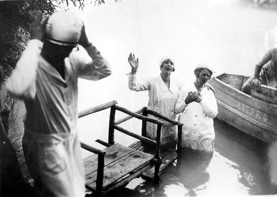 Aimee McPherson, center, about to baptize one of her followers in the River Jordan in Palestine, May 8, 1930. Photo: WIDE WORLD PHOTOS / handout