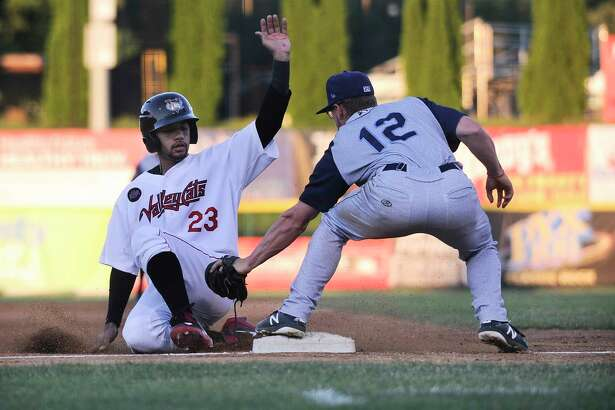 Tri-City ValleyCats Gilberto Celestino (23) is tagged out by Brooklyn Cyclones third baseman Chandler Avant (12) during a minor league baseball game Thursday, July 19, 2018, in Troy, N.Y. (Hans Pennink / Special to the Times Union)