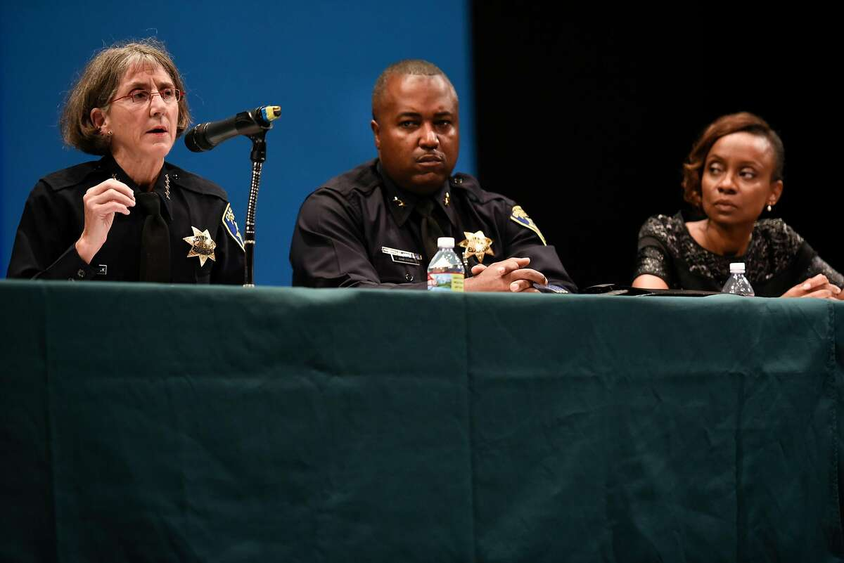 Oakland police chief Anne Kirkpatrick, left, speaks as Oakland assistant chief Leronne Armstrong and Dr. Jennifer Eberhardt listen, during a town hall meeting held at Laney College in Oakland, Calif., on Monday July 19, 2018.