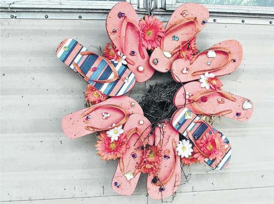 Wrens have built a nest in the center of a wreath made from flip-flops in rural Nortonville.