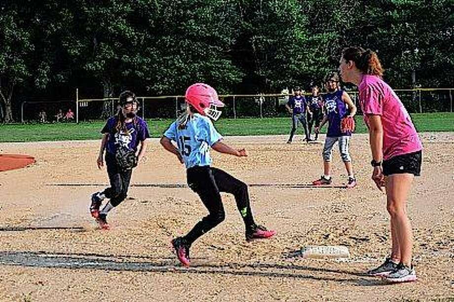 Elisabeth Saxen is safe after reaching first during a Jacksonville Area Baseball game Thursday. This was the last game of the JAB's 10 and under softball league. Photo:       Audrey Clayton | Journal-Courier