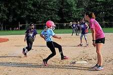Elisabeth Saxen is safe after reaching first during a Jacksonville Area Baseball game Thursday. This was the last game of the JAB's 10 and under softball league.