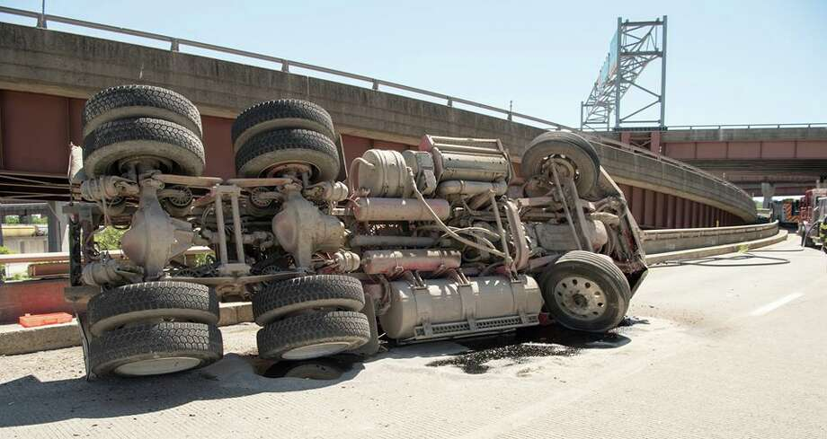 The Albany police and fire departments and the State Police responded to a tractor trailer rollover on Thursday, July 19, 2018, on the ramp from I787 southbound to the Dunn Memorial Bridge and the Empire State Plaza. Roberts Towing and Recovery righted the trailer and helped clear the road. (Steve Smith/Albany Police Department) Photo: Steve Smith/Albany Police Department