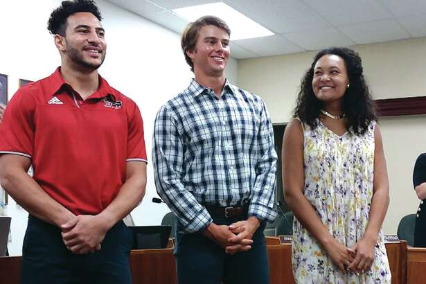 Three SIUE student athletes were honored at Tuesday's City Council meeting. From left are Julian Harvey, Brock Weimer and Madison McKinley. The three not only excelled at athletics, but also as students by maintaining a cumulative grade point average above 3.0.