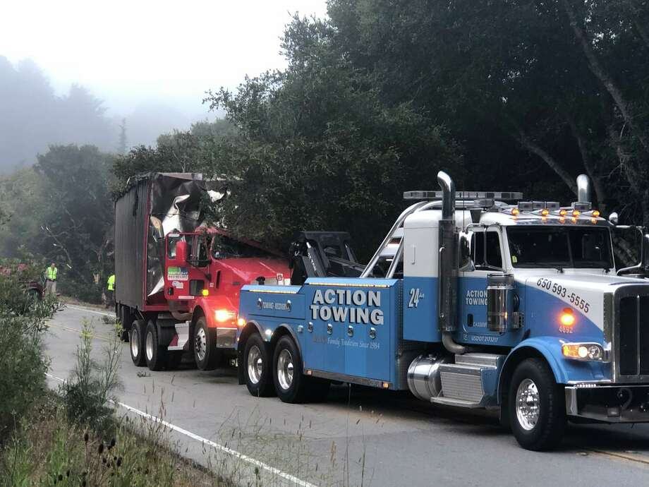 A tow truckWorks to remove overturned big rig on Hwy 92 on Thursday morning, July 20, 2018. Photo: Leigh Martinez / KTVU
