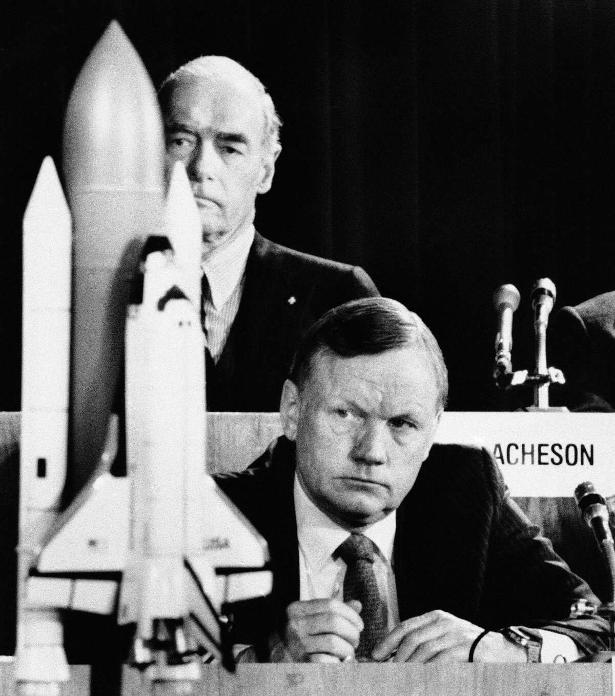 In this Feb. 11, 1986 file photo, former astronaut Neil Armstrong, a member of the presidential panel investigating the Space Shuttle Challenger explosion, listens to testimony before the commission in Washington, as David Acheson, a commission member, listens in the background. When Armstrong became the first man to walk on the moon, he captured the attention and admiration of millions of people around the world. Now fans of Armstrong and of space exploration have a chance to own artifacts and mementos that belonged to the modest man who became a global hero. The personal collection of Armstrong, who died in 2012, will be offered for sale in a series of auctions handled by Dallas-based Heritage Auctions.