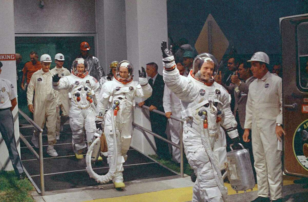 In this July 16, 1969, file photo, Neil Armstrong waving in front, heads for the van that will take the crew to the rocket for launch to the moon at Kennedy Space Center in Merritt Island, Fla. When Armstrong became the first man to walk on the moon, he captured the attention and admiration of millions of people around the world. Now fans of Armstrong and of space exploration have a chance to own artifacts and mementos that belonged to the modest man who became a global hero. The personal collection of Armstrong, who died in 2012, will be offered for sale in a series of auctions handled by Dallas-based Heritage Auctions.