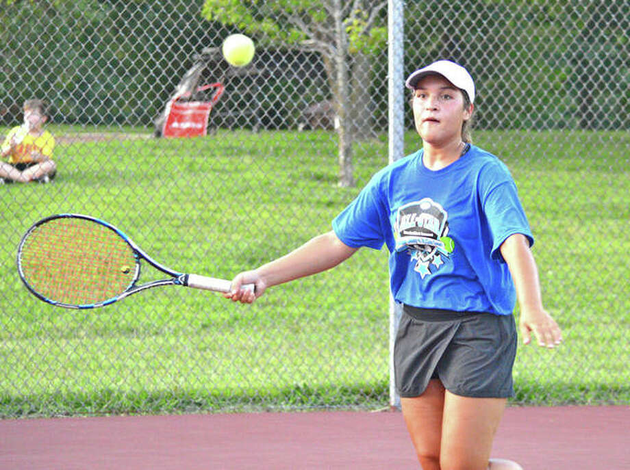 Alton's Hannah Macias prepares to hit a return during Thursday's inaugural High School Tennis All-Star Game at the EHS Tennis Center in Edwardsville. The event featured a Madison County vs. St. Clair County format. Photo:       Scott Marion / Hearst Newspapers