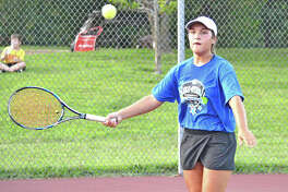 Alton's Hannah Macias prepares to hit a return during Thursday's inaugural High School Tennis All-Star Game at the EHS Tennis Center in Edwardsville. The event featured a Madison County vs. St. Clair County format.