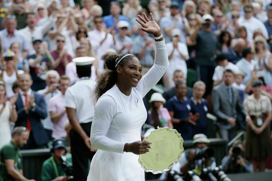 Serena Williams of the US waves to the crowd after being defeated by Angelique Kerber of Germany in the women's singles final match at the Wimbledon Tennis Championships, in London, Saturday July 14, 2018. (AP Photo/Tim Ireland)