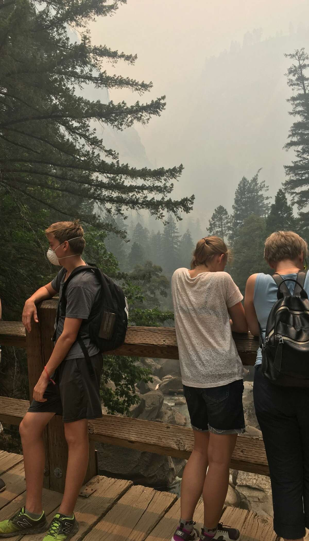 Yosemite visitors wear masks as the Ferguson Fire rages four miles outside the western edge of the park. July 2018