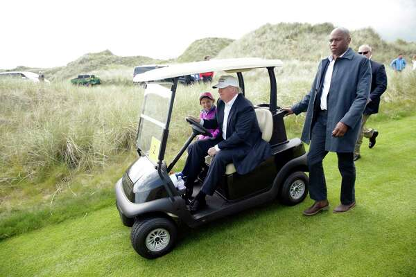 President Donald Trump drives a golf cart at Trump International Golf Links in Aberdeen, Scotland, on June 25, 2016.