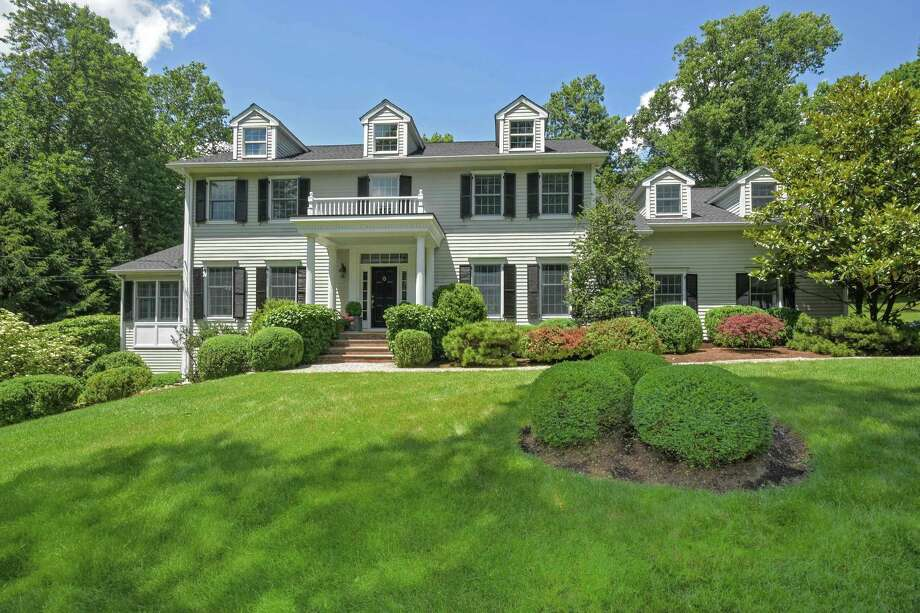 The classic colonial house at 104 Jonathan Road sits on a property of just over two acres two minutes from Scott's Corner in Pound Ridge, New York.