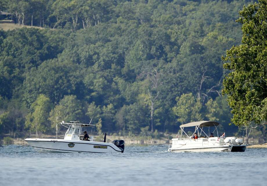 Emergency workers patrol the area on Table Rock Lake in Branson, Mo., near where a duck boat capsized Thursday night. Photo: Charlie Riedel / Associated Press