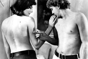 "Vanessa Redgrave and David Hemmings star in Michelangelo Antonioni's ""Blow-Up."""