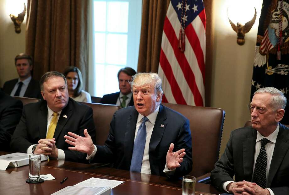 President Trump is flanked by Secretary of State Mike Pompeo, left, and Defense Secretary James Mattis, right, during a Cabinet meeting June 21. Pompeo and Mattis are coming to the Bay Area next week to meet with Australian officials at Stanford University. Photo: Oliver Contreras / TNS