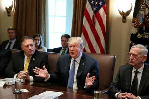 President Donald Trump, flanked by Secretary of State Mike Pompeo, left, and Secretary of Defense James Mattis, right, speaks during a Cabinet Meeting on the Cabinet Room of the White House on June 21, 2018 in Washington, D.C. (Oliver Contreras/SIPA USA/TNS)