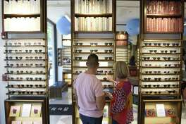 Employees organize frames on display at the new Warby Parker store at 346 Greenwich Ave., in Greenwich, Conn., on Thursday, July 19, 2018.