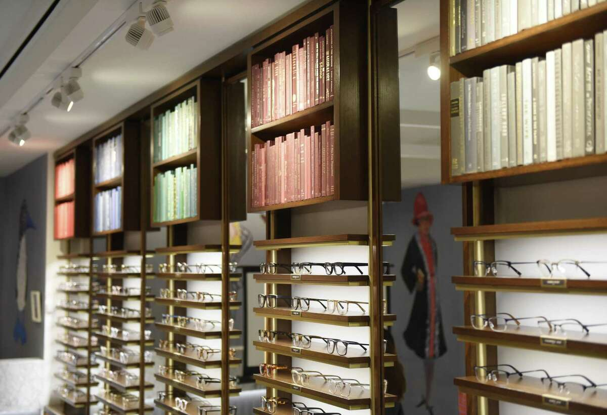 Glasses and books are displayed at the new Warby Parker store at 346 Greenwich Ave., in Greenwich, Conn.