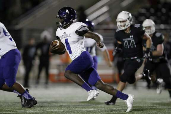 Humble Wildcats running back Isaiah Robinson (4) runs the ball in the first half during the high school football game between the Humble Wildcats and the Kingwood Park Panthers in Humble, TX on Friday, November 10, 2017.