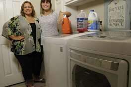 Tammy Hamilton, left, and her daughter Caitlin Hamilton did laundry for people in their River Plantation neighborhood who were affected by Harvey.
