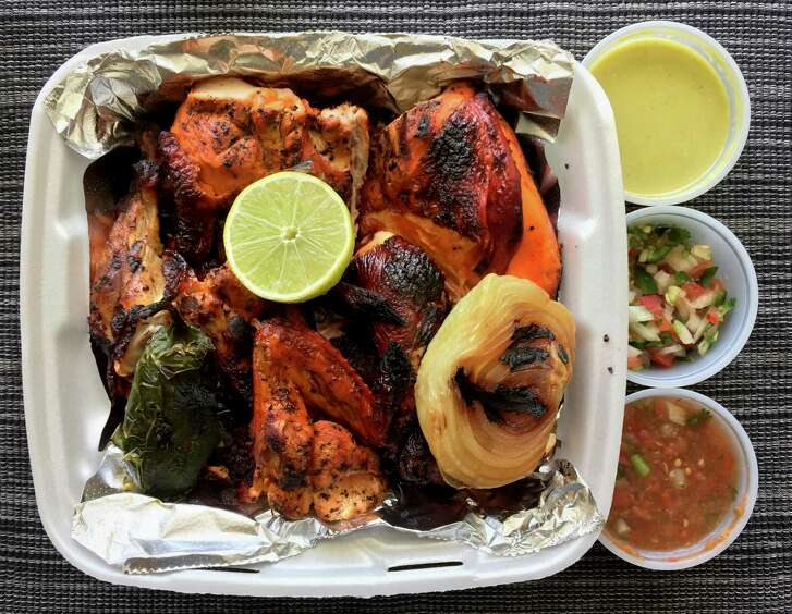Takeout order of grilled chicken from Pollos Asados Don Carbon.