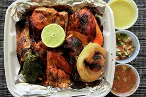 Takeout order of grilled chicken from Al Carbon Pollos Asados.