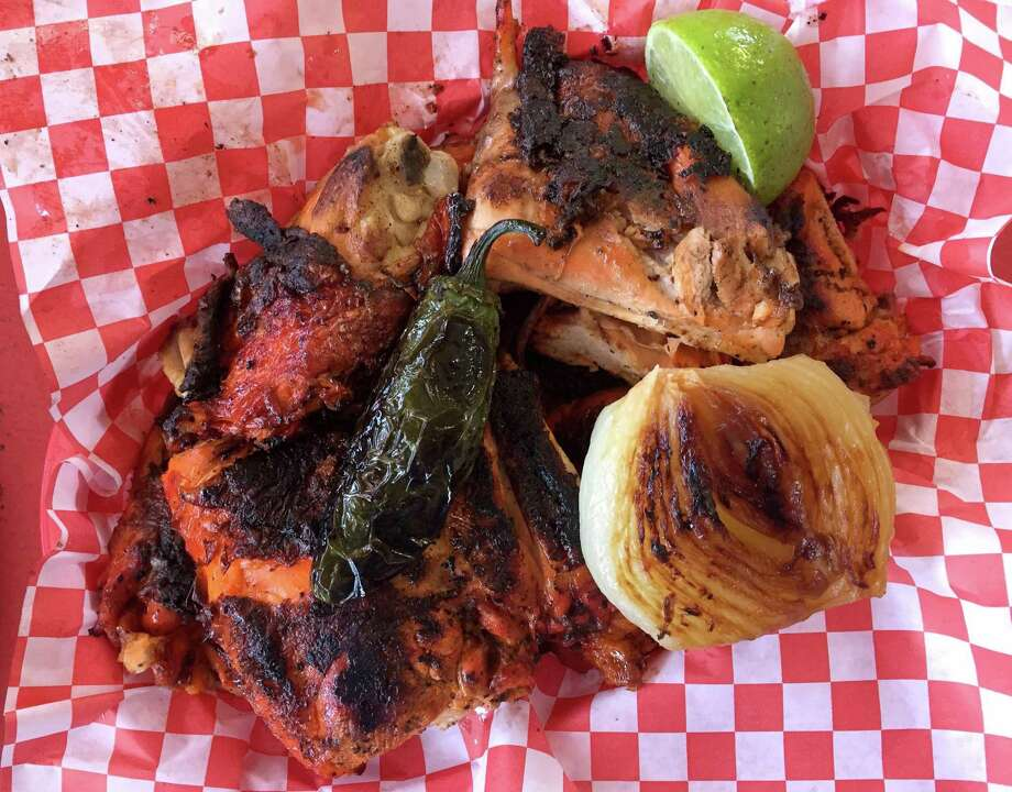An order of grilled chicken from Pollos Asados Don Carbon, now called Al Carbon Pollos Asados following a lawsuit from a similarly named business in El Paso. Photo: Paul Stephen /Staff