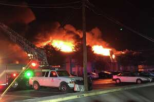 The blaze was first reported around 4:30 a.m. at the Iconic Village Apartments in the 200 block of Ramsay Street. One building was fully engulfed in flames, and another building in the complex was also damage.