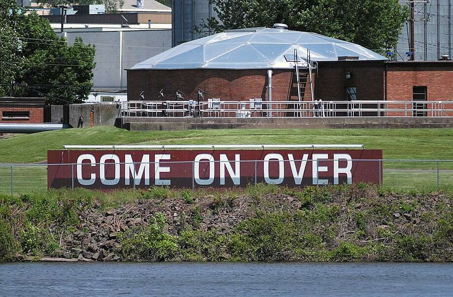 Portland's welcome sign as seen from across the Connecticut River in Middletown Photo: File Photo