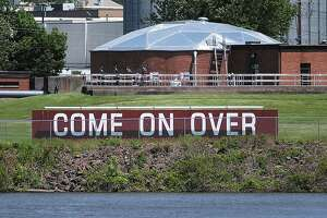 Portland's welcome sign as seen from across the Connecticut River in Middletown