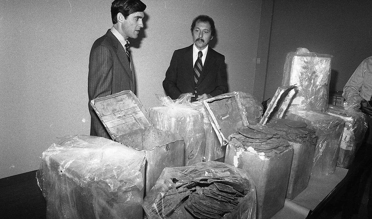 Robert S. Mueller III (l), Assistant U.S. Attorney and Daniel Addario, director DEA regional office inspect hashish from a major bust August 2, 1978