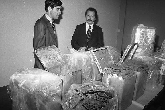 Robert S. Mueller III (l), Assistant U.S. Attorney and Daniel Addario, director DEA regional office inspect hashish from a major bust August 2, 1978