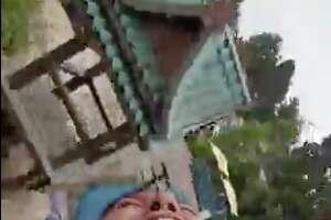 A man screamed in fear as he rode a roller coaster.