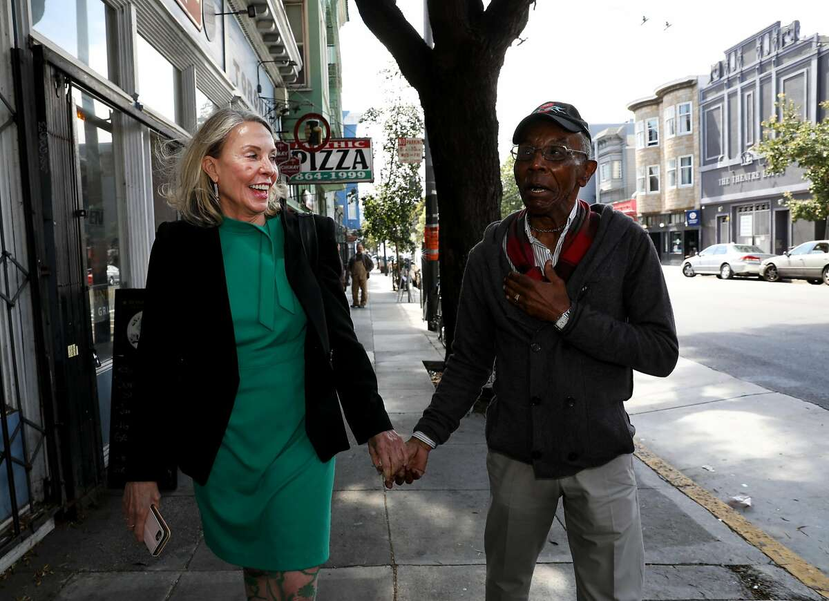 New San Francisco D5 supervisor Vallie Brown, left, talks to resident Paul Willis, 76, as they walk through Lower Haight in San Francisco, Cali. on Thursday, July 19, 2018.