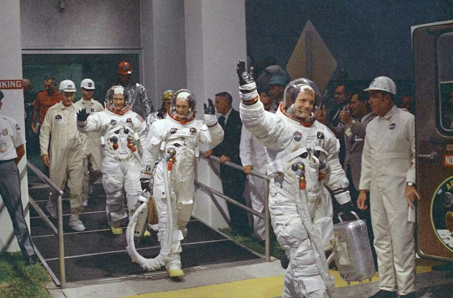 In this July 16, 1969, file photo, Neil Armstrong waving in front, heads for the van that will take the crew to the rocket for launch to the moon at Kennedy Space Center in Merritt Island, Fla. When Armstrong became the first man to walk on the moon, he captured the attention and admiration of millions of people around the world. Now fans of Armstrong and of space exploration have a chance to own artifacts and mementos that belonged to the modest man who became a global hero. The personal collection of Armstrong, who died in 2012, will be offered for sale in a series of auctions handled by Dallas-based Heritage Auctions. Photo: /Associated Press / Copyright 2018 The Associated Press. All rights reserved.