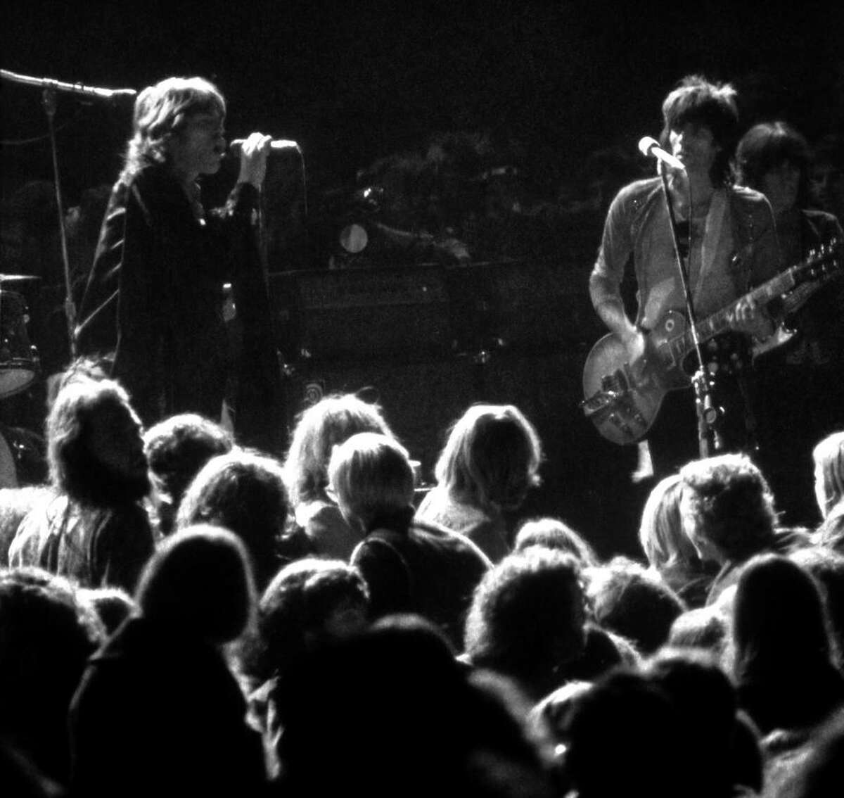 Mick Jagger (left) and Keith Richards perform with the Rolling Stones at the ill-fated Altamont festival.