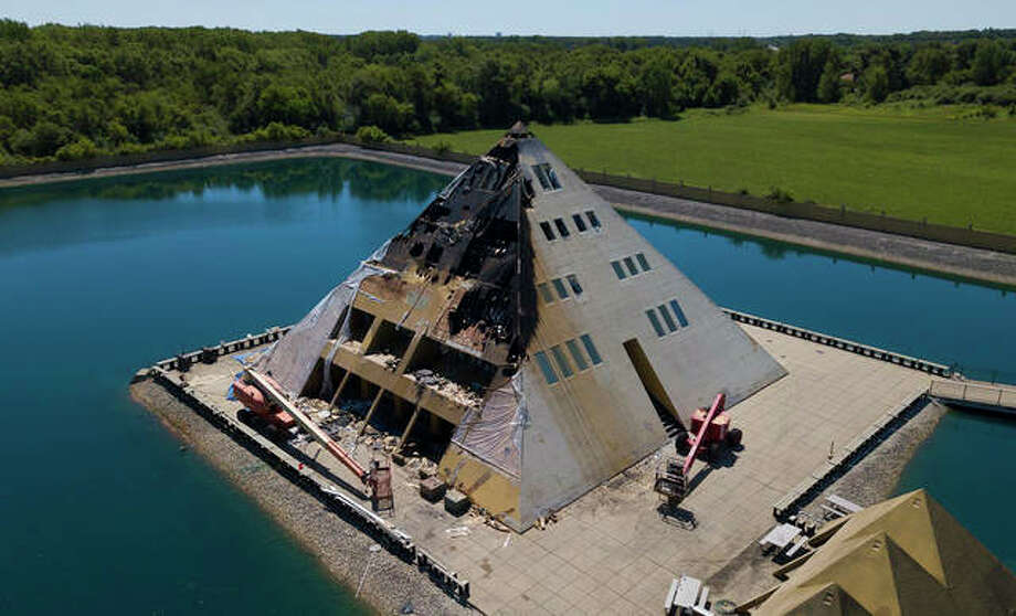 This aerial photo shows fire damage to the Golf Pyramid House Wednesday, July 18, 2018, in Wadsworth, Ill. Fire officials say no people were hurt but a dog died in the Tuesday fire. The Gold Pyramid House was built in 1977 as a private residence but has since opened for public tours. (Mark Welsh/Daily Herald via AP)